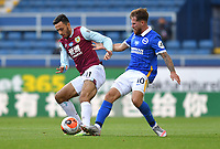 Burnley's Dwight McNeil battles with Brighton & Hove Albion's Alexis Mac Allister<br /> <br /> Photographer Dave Howarth/CameraSport<br /> <br /> The Premier League - Burnley v Brighton & Hove Albion - Sunday 26th July 2020 - Turf Moor - Burnley<br /> <br /> World Copyright © 2020 CameraSport. All rights reserved. 43 Linden Ave. Countesthorpe. Leicester. England. LE8 5PG - Tel: +44 (0) 116 277 4147 - admin@camerasport.com - www.camerasport.com
