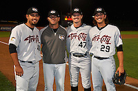 Tri-City ValleyCats pitchers Zac Person (29), Ralph Garza (41) and Kevin McCanna (47) pose for a photo with pitching coach Chris Holt (jacket) after a game against the Aberdeen Ironbirds on August 6, 2015 at Ripken Stadium in Aberdeen, Maryland. Tri-City defeated Aberdeen 5-0 as the trio combined to throw a no-hitter. (Mike Janes/Four Seam Images)