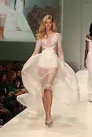 Model walks the runway during a Georges Chakra show on day one of Fashion Houston Spring 2013 Presented By Audi at the Wortham Theatre Center on November 12, 2012 in Houston, Texas. (Photo by Louis Dollagaray/MediaPunch) /NortePhoto