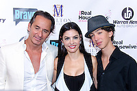 Adriana De Moura and Frederic Marq attend Real Housewives of Miami Season 3 VIP Premiere Party, at Lou La Vie, Miami, FL, on August 6, 2013