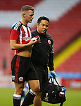 Jake Wright Jnr goes off with physio  during the U23 Professional Development League match at Bramall Lane Stadium, Sheffield. Picture date: September 6th, 2016. Pic Simon Bellis/Sportimage