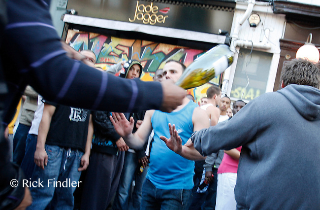 30.08.10 A man is threatened with a bottle at Notting Hill Carnival earlier today.