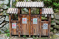 Linkeng, Zhejiang, China.  Bilingual Signs on Waste Bins for Recyclable Trash.