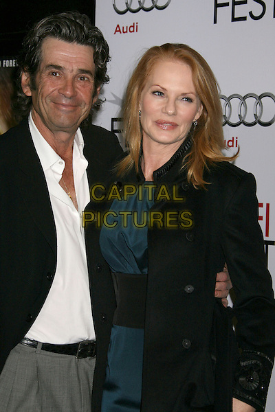 "ALAN ROSENBERG & MARG HELGENBERGER.The AFI Fest's Gala Screening of ""The Road"" at Grauman's Chinese Theatre in Hollywood, California, USA..November 4th 2009.half length black coat jacket white shirt suit  blue teal dress married husband wife.CAP/ADM/MJ.©Michael Jade/AdMedia/Capital Pictures."