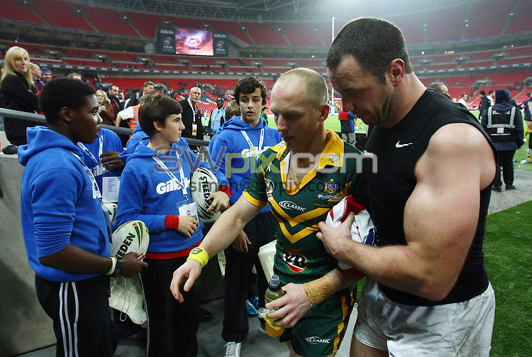 PICTURE BY VAUGHN RIDLEY/SWPIX.COM - Rugby League - Gillette 4 Nations 2011 - England v Australia - Wembley Stadium, London, England - 5/11/11 - England's Adrian Morley and Australia's Darren Lockyer leave the Wembley turf together.