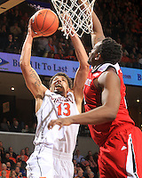Virginia forward Anthony Gill (13) goes up to the basket next to North Carolina State forward Beejay Anya (21) during the game Wednesday Jan. 7, 2015 in Charlottesville, Va. Virginia won 61-51.