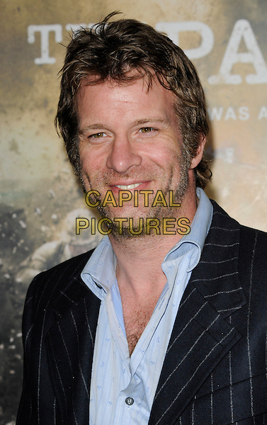 "THOMAS JANE.The Los Angeles premiere of HBO's new miniseries event ""The Pacific"" at Grauman's Chinese Theatre in Hollywood, California.  .February 24th, 2010.headshot portrait blue black stubble facial hair pinstripe.CAP/ROT.©Lee Roth/Capital Pictures"