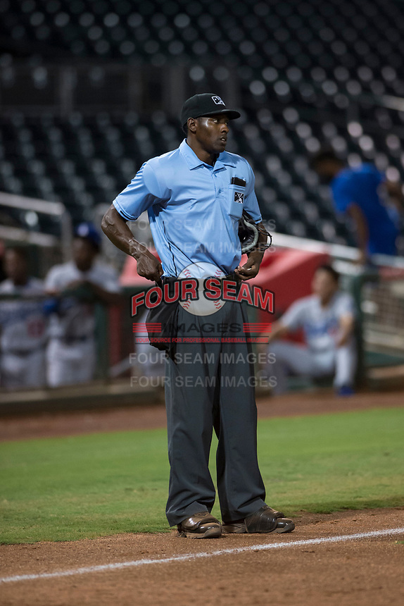 Home plate umpire Demetrius Hicks between innings of an Arizona League game between the AZL Indians 2 and the AZL Dodgers at Goodyear Ballpark on July 12, 2018 in Goodyear, Arizona. The AZL Indians 2 defeated the AZL Dodgers 2-1. (Zachary Lucy/Four Seam Images)