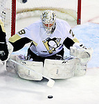 6 February 2010: Pittsburgh Penguins' goaltender Marc-Andre Fleury makes a first period save against the Montreal Canadiens at the Bell Centre in Montreal, Quebec, Canada. The Canadiens defeated the Penguins 5-3. Mandatory Credit: Ed Wolfstein Photo