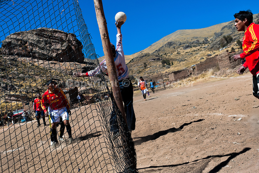 Indigenous men play football on a dirt field in the rural mountain community close to Puno, Peru, 6 August 2012. Football, the most popular sport in Latin America, is widely played even in the remote and sparsely populated places in the mountains and jungles. The 2014 FIFA World Cup in Brazil is the most eagerly anticipated sporting event for all Latin Americans.