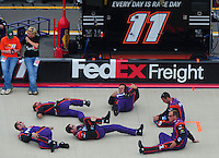 Apr 27, 2008; Talladega, AL, USA; Crew members for NASCAR Sprint Cup Series driver Denny Hamlin (not pictured) stretch prior to the Aarons 499 at Talladega Superspeedway. Mandatory Credit: Mark J. Rebilas-