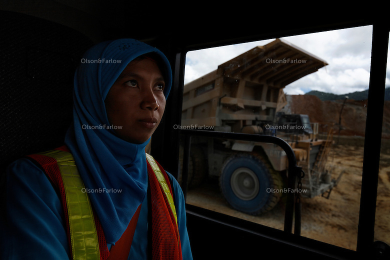 Islamic woman are the best drivers at Batu Hijau (Newmont) gold and copper mine.  Aisma Tutu is a local Sumbaya woman from the village of Jereveh, she drives a truck that has 240 tons of rock that will yield about nine ounces of gold.  The extraction average at Batu Hijau is .03 ounces of gold and .06 ounces of copper for every ton of rock that gets processed.  These Islamic women listen to the country music that is piped into the cab and I also heard a one hour show of christian gospel music.  The company says they want loud music in the cabs to keep them awake.