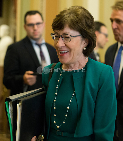 United States Senator Susan Collins (Republican of Maine) walks to the US Senate Chamber for a procedural vote in the US Capitol in Washington, DC on Friday, December 1, 2017. <br /> Credit: Alex Edelman / CNP /MediaPunch