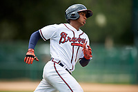 GCL Braves right fielder Joel Reyes (25) runs to first base during the second game of a doubleheader against the GCL Yankees West on July 30, 2018 at Champion Stadium in Kissimmee, Florida.  GCL Braves defeated GCL Yankees West 5-4.  (Mike Janes/Four Seam Images)