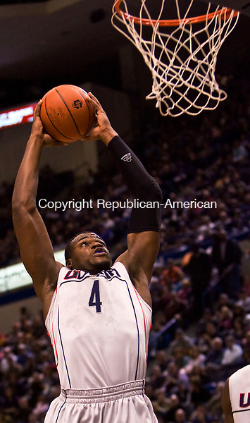 HARTFORD, CT - 18 JANUARY 2009 -011809JT10-<br /> UConn's Jeff Adrien makes a slam dunk during Sunday's game against Seton Hall at the XL Center in Hartford. UConn won, 76-61.<br /> Josalee Thrift / Republican-American