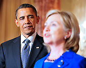 United States President Barack Obama, left, looks on as U.S. Secretary of State Hillary Rodham Clinton, right, makes remarks at a reception in honor of Foreign Minister S.M. Krishna of India (not pictured) at the State Department  in Washington, D.C. on Thursday, June 3, 2010..Credit: Ron Sachs - Pool via CNP