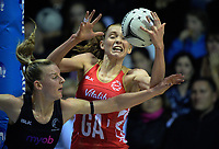 England goal attack Helen Housby beats Katrina Grant (left) to a pass during the Quad Series netball match between the New Zealand Silver Ferns and England Roses at Trusts Stadium, Auckland, New Zealand on Wednesday, 30 August 2017. Photo: Dave Lintott / lintottphoto.co.nz