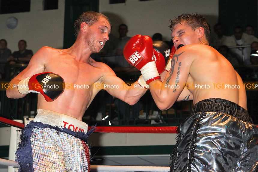 Ryan Toms (silver shorts) defeats Daryl Setterfield in a Middleweight boxing contest at York Hall, Bethnal Green, promoted by Left Jab - 10/10/10 - MANDATORY CREDIT: Gavin Ellis/TGSPHOTO - Self billing applies where appropriate - Tel: 0845 094 6026
