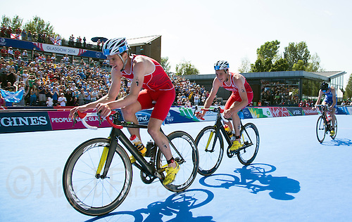 24 JUL 2014 - GLASGOW, GBR - Jonathan Brownlee (ENG) (left) from England leads the front pack of his team mate and brother Alistair Brownlee (centre) and Scotland's Marc Austin (SCO) (right) during the bike at the elite men's 2014 Commonwealth Games triathlon in Strathclyde Country Park, in Glasgow, Scotland (PHOTO COPYRIGHT &copy; 2014 NIGEL FARROW, ALL RIGHTS RESERVED)<br /> *******************************<br /> COMMONWEALTH GAMES <br /> FEDERATION USAGE <br /> RULES APPLY<br /> *******************************