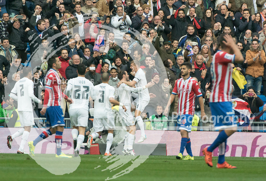 Real Madrid's Welsh forward Gareth Bale celebrates with teammates after scoring