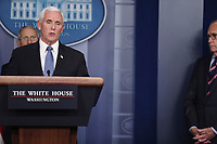 United States Vice President Mike Pence, speaks during a press conference with members of the coronavirus task force in the Brady Press Briefing Room of the White House on March 24, 2020 in Washington, DC.  Director of the National Economic Council Larry Kudlow stands at far right.<br /> Credit: Oliver Contreras / Pool via CNP/AdMedia