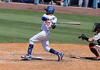 25th July 2020, Los Angeles, California, USA;  Los Angeles Dodgers outfielder Mookie Betts (50) makes contact with the ball during the game against the San Francisco Giants on July 25, 2020, at Dodger Stadium in Los Angeles, CA.
