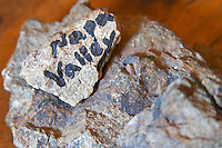 In the tasting room a soil sample stone marked with Napa Valley... Domaine Yves Cuilleron, Chavanay, Ampuis, Rhone, France, Europe