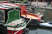 Three houseboats on a single temporary mooring, Grand Union canal, Kings Cross. The number of people living on London canals has risen sharply as a result of rising rents and property prices.