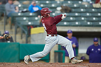James McConnon (14) of the Saint Joseph's Hawks follows through on his swing against the Western Carolina Catamounts at TicketReturn.com Field at Pelicans Ballpark on February 23, 2020 in Myrtle Beach, South Carolina. The Hawks defeated the Catamounts 9-2. (Brian Westerholt/Four Seam Images)
