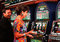 Couple playing slot machines