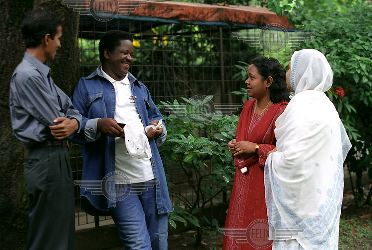 Harrison Masereka, a VSO volunteer from Uganda, talks to some Bangladeshi colleagues during his posting in Dhaka where he was working with HIV/AIDS projects.