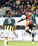 Nederland, Nijmegen, 3 februari 2013.Eredivisie .Seizoen 2012-2013.N.E.C.-Vitesse.Navarone Foor van N.E.C. en Theo Janssen van Vitesse strijden om de bal.