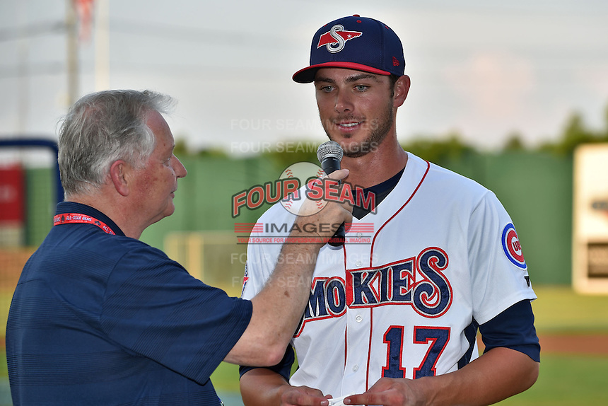 Tennessee Smokies third baseman Kris Bryant #17 talks with the announcer after winning the Southern League Home Run Derby at Engel Stadium on June 16, 2014 in Chattanooga, Tennessee.  (Tony Farlow/Four Seam Images)