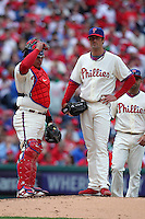 Philadelphia Phillies starting pitcher Cole Hamels #35 and catcher Carlos Ruiz wait during a pitching change during their home opener against the Miami Marlins at Citizens Bank Park on April 9, 2012 in Philadelphia, Pennsylvania.  Miami defeated Philadelphia 6-2.  (Mike Janes/Four Seam Images)