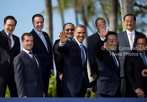 United States President Barack Obama and world leaders wave as they pose during the Asia-Pacific Economic Cooperation (APEC) family photo session at the J.W. Marriott Hotel in Honolulu, Hawaii on Sunday, November 13, 2011.  From left to right: President Lee Myung-bakof South Korea; President Dmitry Medvedev of Russia; Economy Secretary Bruno Ferrari of Mexico; President Obama; Prime Minister Peter O'Neill of Papua New Guinea; Prime Minister Yoshihiko Noda of Japan; President Benigo Aquino III of the Philippines; Sultan of Brunei Hassanal Bolkiah; and Special Envoy Dr. Lien Chan of Taiwan..Credit: Kent Nishimura / Pool via CNP