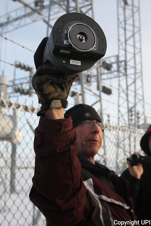 Activists Stuart Wellingham holds one of two FBI surveillance cameras found at a power station near the Malheur National Wildlife Reserve on January 15, 2016 in Burns, Oregon.  Ammon Bundy and about 20 other protesters took over the refuge on Jan. 2 after a rally to support the imprisoned local ranchers Dwight Hammond Jr., and his son, Steven Hammond. Another surveillance camera was found near the reserve.    Photo by Jim Bryant/UPI