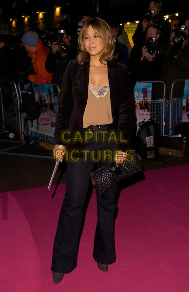 "RACHEL STEVENS.The UK Film Premiere of ""St. Trinian's"" held at the Empire Leicester Square, London, England..December 10th 2007.full length black jacket clutch bag purse grey gray trousers belt brown top.CAP/CAN.©Can Nguyen/Capital Pictures"