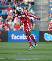 Chicago defender Cory Gibbs (5) heads the ball.  The Chicago Fire defeated Toronto FC 2-0 at Toyota Park in Bridgeview, IL on August 21, 2011.