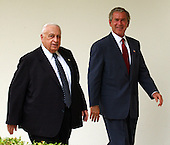 Prime Minister Ariel Sharon of Israel and United States President George W. Bush walk on the collonnade at the White House after meeting reporters in the Rose Garden at the White House in Washington, D.C. on July 29, 2003 following their talks.  They were to have lunch in the Residence.<br /> Credit: Ron Sachs / CNP