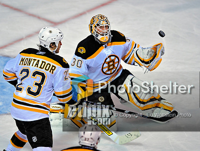 22 April 2009: Boston Bruins goaltender Tim Thomas makes a third period save against the Montreal Canadiens at the Bell Centre in Montreal, Quebec, Canada. The Bruins, up three games to none, eliminated the Canadiens from Stanley Cup competition with a 4-1 win and a series sweep. ***** Editorial Sales Only ***** Mandatory Credit: Ed Wolfstein Photo