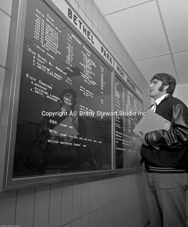 Bethel Park PA:  View of the new high school records case in the Gym Building Lobby.  Charlie Previs looking at the extensive list of Bethel Park Swimming Records - 1973.