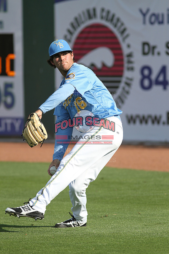 Myrtle Beach Pelicans pitcher Cody Buckel #16 warming up in the outfield before the first game of a doubleheader against the Carolina Mudcats at Tickerreturn.com Field at Pelicans Ballpark on May 10, 2012 in Myrtle Beach, South Carolina. Myrtle Beach defeated Carolina by the score of 2-1. (Robert Gurganus/Four Seam Images)