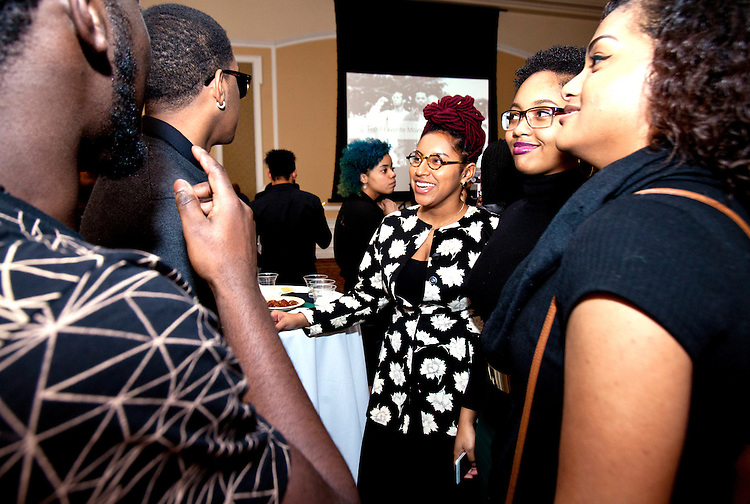 "Attendees were encouraged to ask and answer questions such as ""Tell a Crazy Family Story"" at the All Black Affair at Baker University Center Ballroom at Ohio University on Friday, January 29, 2016. © Ohio University / Photo by Sonja Y. Foster"