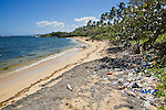 Garbage and plastic bottles litter a beautiful beach, Cofresi, Dominican Republic