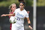 02 October 2011: Duke's Gilda Doria (21) and Virginia Tech's Kelly Conheeney (behind). The Duke University Blue Devils defeated the Virginia Tech Hokies 1-0 at Koskinen Stadium in Durham, North Carolina in an NCAA Division I Women's Soccer game.
