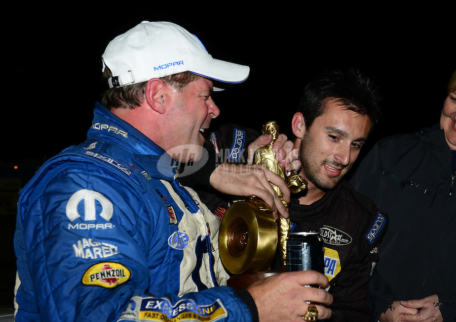 Nov. 11, 2012; Pomona, CA, USA: NHRA Vincent Nobile (right) congratulates pro stock driver Allen Johnson who celebrates after winning the Auto Club Finals at at Auto Club Raceway at Pomona. Mandatory Credit: Mark J. Rebilas-