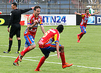 PASTO -COLOMBIA, 26-OCTUBRE-2014. Emanuel  Molina del Deportivo Pasto celebra el gol del empate ente el  Atletico Junior . Accion de juego entre los equipos Deportivo Pasto y Atletico Junior   partido de la fecha 16 de la Liga Postobon II 2014 jugado en el estadio Libertad de la ciudad de Pasto./ Emanuel Molina player of Deportivo Pasto celebra his goal against Atletico Junior . Action game between Deportivo Pasto and Atletico Junior team match of the day 16 of the 2014 Liga Postobon II played in the Liberty Stadium Pasto during match valid for the 16th date of Postobon League II 2014 played at Libertad stadium in Pasto city. Photo: VizzorImage  / Leonardo Castro / Stringer