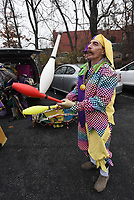 NWA Democrat-Gazette/FLIP PUTTHOFF<br /> MARDIS GRAS ON PARADE<br /> Don Greenway of Fayetteville practices juggling Saturday Feb. 10 2018 before marching in the Fat Saturday Parade of Fools Mardis Gras parade in Fayetteville. Floats, Mardis Gras costumes, Cajun music, candy and lots and lots of party beads were part of the parade. Grand Marshal of the festivities was Dixie Rhyne, one of founders of the parade. The route circled the town square and rolled down Dickson Street.