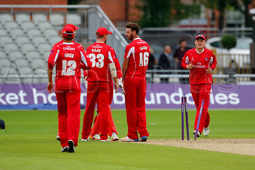July 23rd 2017; Emirates Old Trafford, Manchester, England; Natwest T20 Blast; Lancashire versus Durham; Jordan Clark of Lancashire is congratulated by his team mates after bowling Jack Burnham and Durham are 78-3 in response to the Lancashire score of 174-5