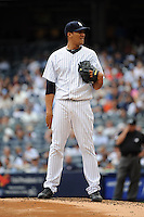 New York Yankees pitcher Hector Noesi #64 during a game against the Tampa Bay Rays at Yankee Stadium on September 21, 2011 in Bronx, NY.  Yankees defeated Rays 4-2.  Tomasso DeRosa/Four Seam Images